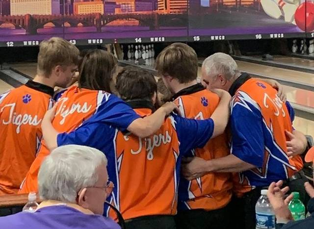 Photo Courtesy Galion Tigers Athletics Facebook page Member of the Galion Bowling team huddle up for a pep talk at Wayne Webb's Columbus bowling facility Friday in Columbus. The Tigers made it to the championship round in the Division II state bowling tournament, where they knocked off top-seeded Peninsula Woodridge, but then fell to eventual state champion Coldwater. The Tigers were fourth overall