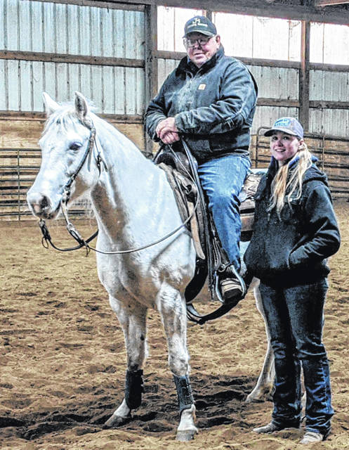Jack McDonald, owner of JM Cutting Horses with Julie Beeh, who works to train and show cutting horses.