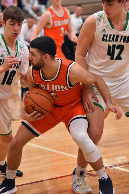 Photo by Don Tudor Galion High School senior Isaiah Alsip, shown here in his last game this week vs. Clear Fork, was named to the all Mid-Ohio Athletic Conference first team. He was the top scorer in the MOAC, and among the league leaders in most other statistical categories.