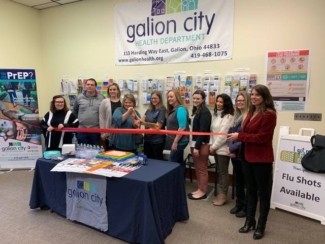 Photo by Jodi Myers City of Galion and Galion-Crestline Area Chamber of Commerce representatives were on hand Tuesday as the Galion City Health Department held a ribbon cutting for its new sexual health clinic. It serves a nine-county, and among other services, offers testing for STDs and HIV.