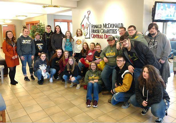 Courtesy photo  Northmor JOG and Youth Safety Council went to the Ronald McDonald House on Jan. 22 to deliver eight boxes of pop tabs and four large bags of fleece blankets. They also delivered a check for $1,850.