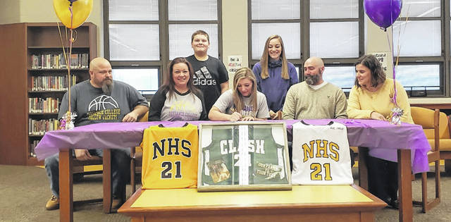 Northmor senior Taylor Linkous signs her letter of intent to play basketball for Defiance College. In the picture are (l-r): stepfather Curtis Adams, mother Jodi Adams, stepbrother Jacob Adams, Linkous, sister Mikayla Linkous, father Michael Linkous and stepmother Julia Linkous.