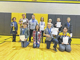 Courtesy photo Fourteen Morrow County students from Cardington, Highland and Northmor took part in the recent Morrow County Spelling Bee. The winner was Caitlyn Thieret, an eighth-grader at Highland.