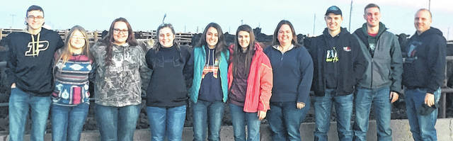 Five Rivers Gilcrest Cattle feeding yard in LaSalle, Colorado. From left: Bryce Schott of Fredericktown; Taylor Rush of Cardington; Kayla Carlyle of Cardington; Mackenzie Grandstaff of Mt. Gilead; Cassidy Small of Fredericktown; Ellie Kidwell of Walhonding; Amanda Forquer of Mount Gilead, 4-H Educator; Colton Boyer of Lucas; Ethan Staley of Fredericktown and Adam Staley of Fredericktown, 4-H Livestock Judging Coach.