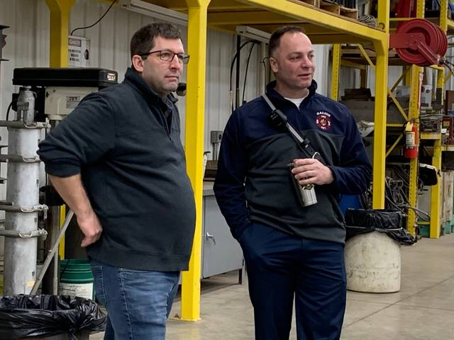 Photo by Jodi Myers Crawford County emergency management director Kirk Williamson talks with Galion fire chief Phil Jackson before Wednesday's disaster drill near Crestline.