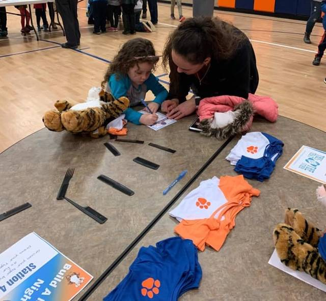 Courtesy photo Family's got together last week in a Galion City Schools gym to build their own Galion Tigers mascots. The event was a fundraiser the districts PTO.