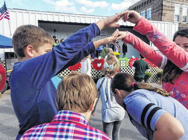 Galion Inquirer file photo On Friday's at the Apple Fest, kids get dismissed from school and perform at the main stage at the fest. Kathie Kinley, wife of Ken Kinley, helps with the kids and their music.