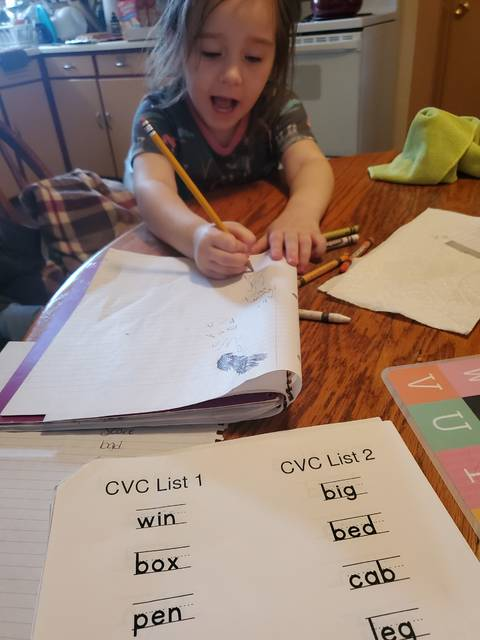 Courtesy photo Chelsie Steele's six-year-old daughter tackles her classroom assignments.