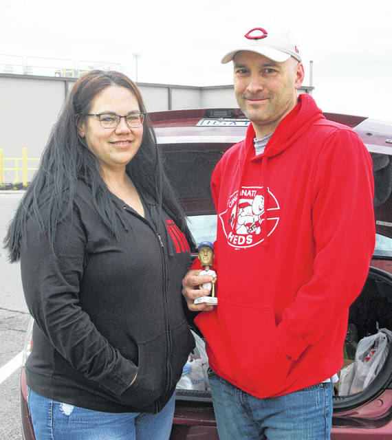 Bill Frueh, right, with Heather Wood have found a lucrative market selling items online.
