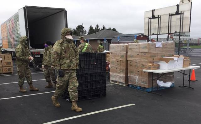 Courtesy photo Members of the Ohio National Guard were on hand Monday in Bucyrus to help Second Harvest with a drive-thru food pantry. Almost 800 vehicles received a box of supplies to help get them through the on-going COVID-19 crisis. The Ohio Highway Patrol directed traffic and numerous volunteers helped to pack up boxes and deliver them to those waiting in line.