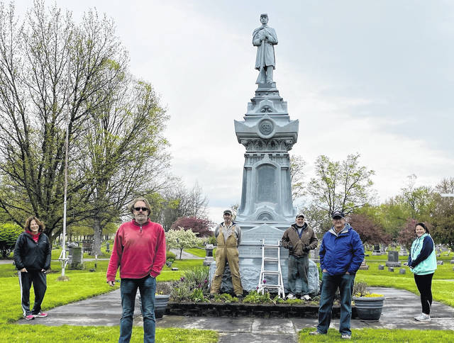 Members of the Civil War Monument repair committee and Glendale Cemetery officials in front of the Civil War Monument when a panel was removed recently for looking inside it for the first time.