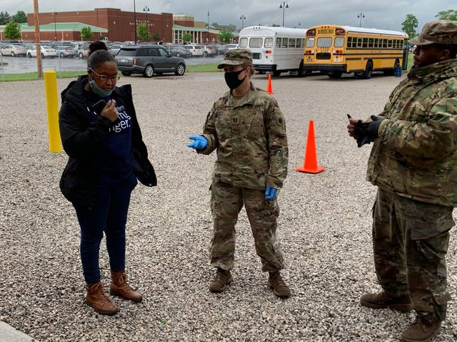 Photo by Jodi Myers Giving instructions before Friday's food distribution on the Galion City Schools campus are Brittney Hopkins (left), Program Education Coordinator with the Second Harvest Food Bank, and Capt. Stephanie Duarte with the Army National Guard. More than 450 families were served.