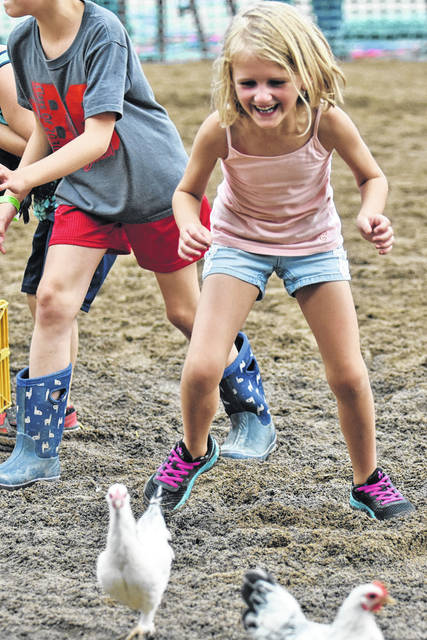 Galion Inquirer file photo These kids were trying to catch chickens to win prizes last year at the Crawford County. There are more of these events planned this year. The fair is July 20-25.