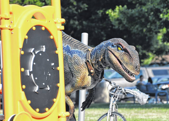 Photo by Don Tudor There were all kinds of visitors to the Heise Park area Saturday during Galion's Independence Day Celebration. One of the visitors was a dinosaur, who stopped in to visit with and make friends.