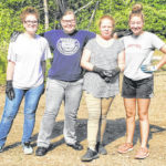 Summer Youth Program workers collecting debris along Galion's new bike path