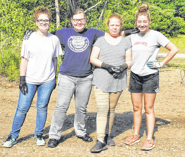 Courtesy photo Galion's Danielle Alexander, Lilah Auck and Nasya Riddle, along with Vanessa Jennings, of Bucyrus, have spent part of their summer helping to remove debris from Galion's new bike path, which soon will open to the public. The girls are part of the Youth Work Program operated by Goodwill Industries and also have done some sprucing up of Historic Uptowne Galion.