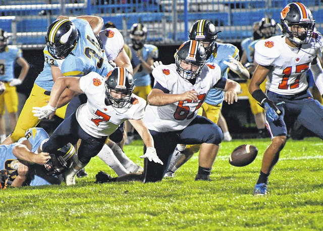 Galion players go after a loose ball Friday night against River Valley. The Tigers fell 20-19 to the host Vikings in the MOAC season opener.