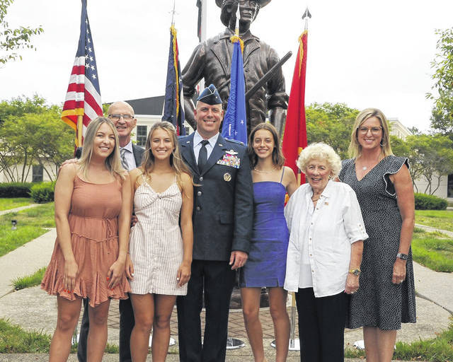 Photo by Todd Cramer | Ohio National Guard   Newly promoted Brig. Gen. Gary McCue, director of the joint staff for the Ohio National Guard, stands for a photo with his family following his promotion ceremony Aug. 7, 2020, at the Maj. Gen. Robert S. Beightler Armory in Columbus. Pictured are daughter Emily McCue (from left), father-in-law Rod McElfresh, daughter Carly McCue, Brig. Gen. McCue, daughter Zoe McCue, mother Rosemary McCue and wife Molly McCue.