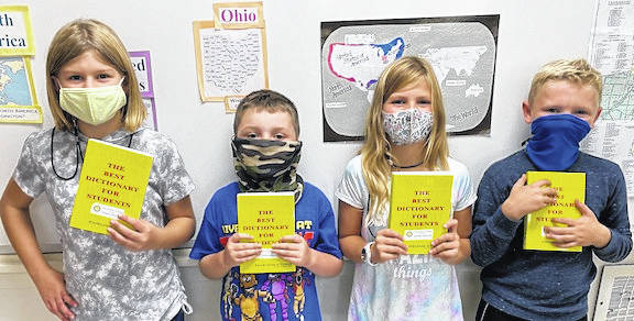 These are some of the Cardington-Lincoln third grade students who received dictionaries from the Cardington Rotary Club. From left: Sofia Ritter, Michael Baker, Carly Whitaker and Lane Carrigan.