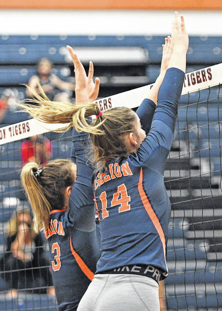 Galion Inquirer file photo  Galion's Ashley Dyer (3) and Keely Knight (14) go up for a block vs. Marion Harding last month in a Mid-Ohio Athletic Conference volleyball game at the high school. The Lady Tigers earned a No. 2 seed in their Division II sectional/district draw. Having received a first round bye, they will play Oct. 21 for a sectional championship against Shelby or Clear Fork.
