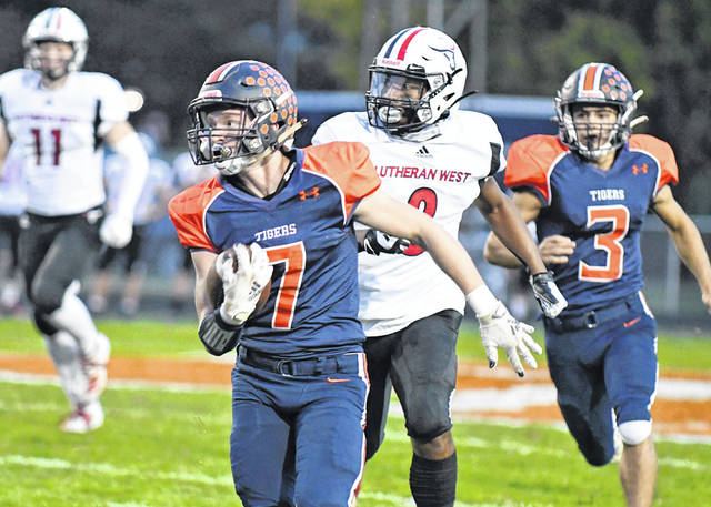 Photo by Don Tudor   Galion's Gage Vanderkooi runs back a first-quarter interception in Saturday's 55-7 win over Rocky River Lutheran West. The pick led to Galion's first touchdown.