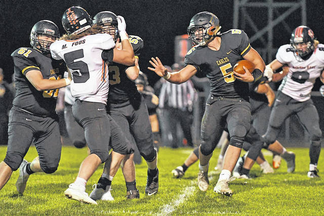 Photo by Don Tudor Colonel Crawford running back Tristan Cross runs behind his line Saturday in the Eagles' 44-6 second-round playoff win over Seneca East. Cross scored four touchdowns.
