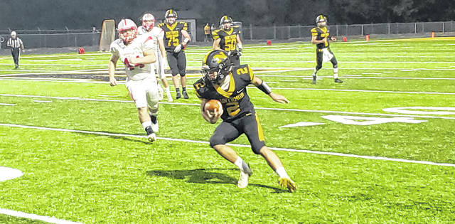 Trenton Ramos heads up the field after catching a pass in Northmor's Saturday playoff game.