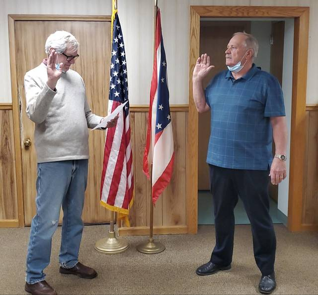 Galion Mayor Tom O'Leary, left, swears in Gail Baldinger as the new city auditor on Wednesday. His appointment begins Nov. 28 at midnight.