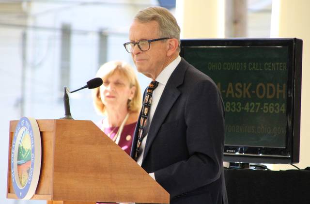 """Ohio Gov. Mike DeWine, shown here during a stop on Oct. 8 at the Harding Presidential Sites in Marion, issued a revised mask order during a press conference on Wednesday, Nov. 11, 2020. Under provisions of the order, retail businesses will be required to post a """"Face Covering Requirement"""" sign at all public entrances to the store. Stores will also be responsible for ensuring that employees and customers wear masks. The third provision is the formation of a new """"Retail Compliance Unit,"""" which is comprised of agents from the Bureau of Workers Compensation. The unit will conduct inspections to ensure compliance."""