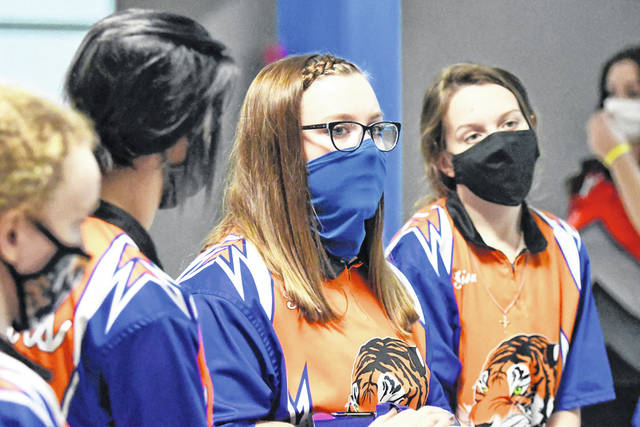 Members of the Galion High School girls bowling team wait for their turn to compete in the Victory Lanes Warm-Up Tourney on Saturday, Nov. 21, 2020. The Tigers finished with a total score of 2,694 to win the tournament.