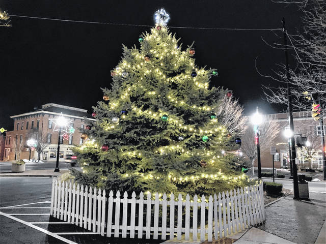 The Galion community Christmas tree was lighted for the 2020 holiday season on Saturday, Dec. 5, 2020, during an abbreviated version of the Come Home to Galion event. Local minsters conducted a brief ceremony to share the Christmas story from Luke 2 in the New Testament of the Bible and sing Christmas carols.