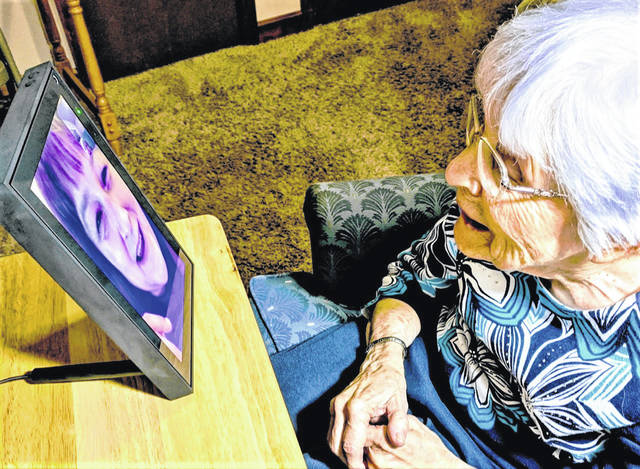 A Magnolia Terrace Assisted Living resident talks with a family member using Facebook Portal. Magnolia Terrace officials are distributing the devices to each of their residents in hopes of improving and expanding communication opportunities with family members and friends outside of the facility. Officials said they hope to expand the use of automated services at Magnolia Terrace to benefit all residents.