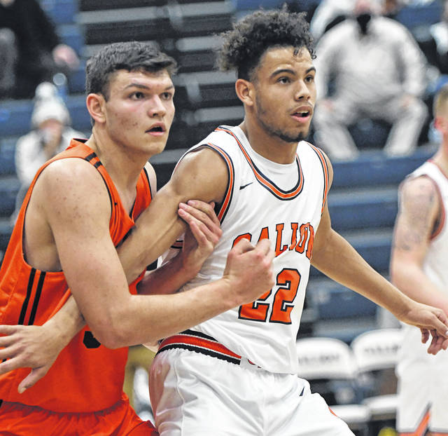 Galion's Hanif Donaldson (22) battles Upper Sandusky's Trent Beamer for position during the season-opening game for both programs on Wednesday, Dec. 2, 2020. Upper Sandusky prevailed 64-47. Donaldson led the Tigers with 12 points and 11 rebounds.