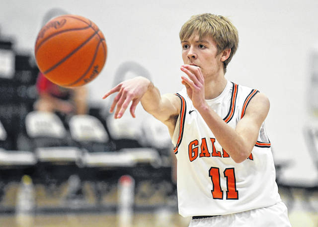Galion junior guard Jaxon Oswald passes the ball to a teammate during the Mid Ohio Athletic Conference game against Marion Harding on Thursday, Dec. 10, 2020. Oswald led the Tigers in scoring with eight points against the Presidents. Harding won the game, 60-25.