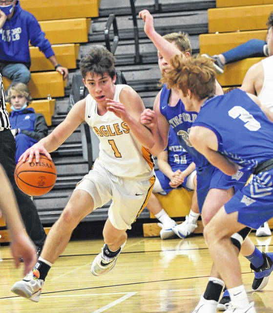 Colonel Crawford guard Mason Studer (1) drives to the basket during the Northern 10 Athletic Conference game against Wynford played Saturday, Dec. 19, 2020, at Mac Morrison Gym in North Robinson. Studer finished with 13 points and the Eagles defeated the Royals 70-45 to remain unbeaten.