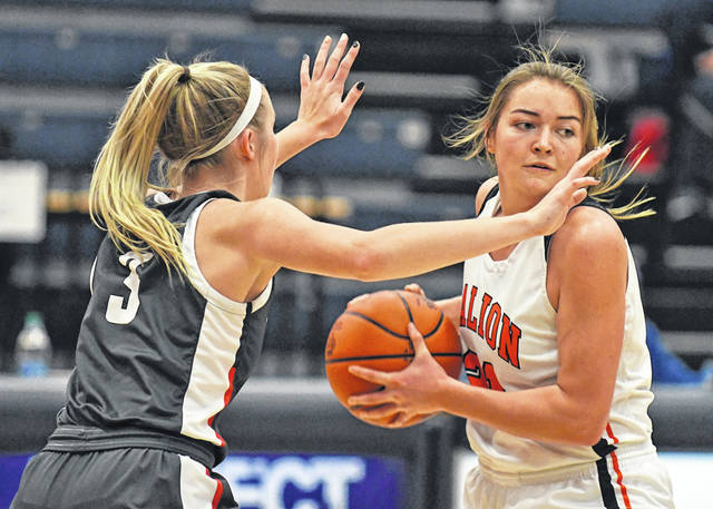 Galion's Natalee Perkins looks for an open teammate under pressure from Haylee Baker of Shelby during the Mid Ohio Athletic Conference girls basketball contest on Wednesday, Dec. 30, 2020, at Galion High School. Shelby won, 65-29.