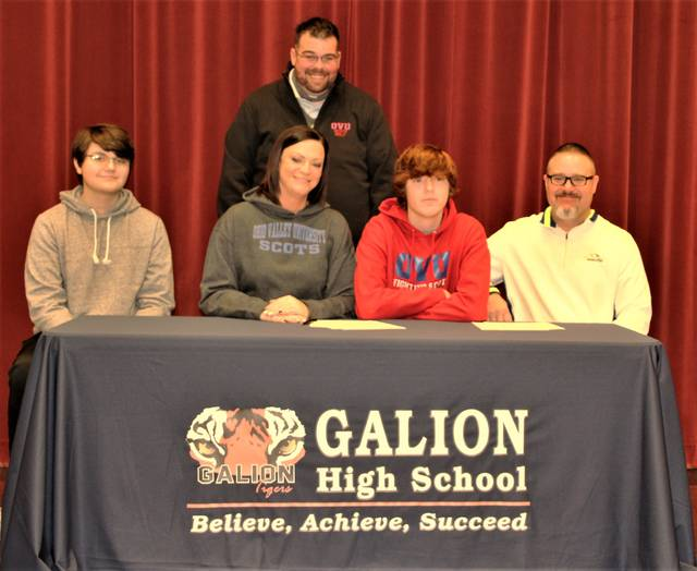 Galion High School golfer Bronson Dalenberg, seated, second from right, has signed a national letter of intent to continue his career at Ohio Valley University in Vienna, West Virginia. Seated on either side of Dalenberg are his mother, Melissa Jackson, and father, Chad Dalenberg. His stepfather, Ty Jackson, is standing, and his brother, Brady Dalenberg is seated far left.
