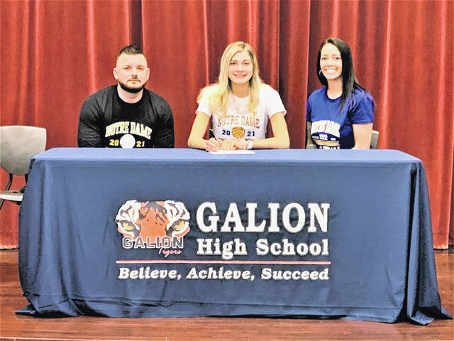 Galion High School volleyball standout Samantha Comer, center, signed a national letter of intent to play for Notre Dame College during a ceremony held Monday, Jan. 25, 2021, at the high school. She is shown with her mother and stepfather, Denise and Timothy McDaniel.