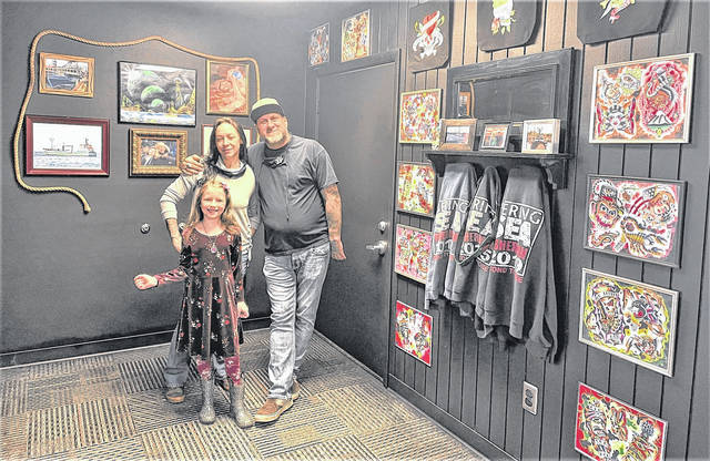 """Sailor Dave"" Rohr, right, is the owner of SD Tattoo, located at 21 Public Square in Galion. Rohr, who has worked as a tattoo artist since 1997, opened SD Tattoo in December 2020. Rohr is shown in his shop with his fiance Amber Nafziger and her daughter Silver Sands. For information, go to the shop's Facebook page SD Tattoo Galion."