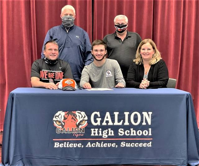 Galion High School golfer Spencer Keller (seated, center) has signed a letter of intent to play golf at Indiana Tech in Fort Wayne, Indiana. He put pen to paper on Tuesday, Jan. 12, 2021. Keller is shown with his parents, Tim and Melissa. Standing behind the Keller family are Galion boys golf coach Bryce Lehman (left) and Indiana Tech coach Kelly Mettert.
