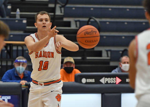 Galion's Carter Keinath passes the ball to a Tigers teammate during the Mid Ohio Athletic Conference boys basketball game against Pleasant on Tuesday, Jan. 26, 2021. The Spartans rallied from a 26-21 halftime deficit to defeat Galion 56-42.
