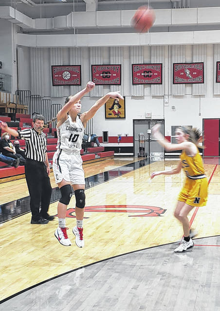 Dana Bertke looks for three points against Northmor on Saturday. Cardington's girls connected 10 times from long range in their win.