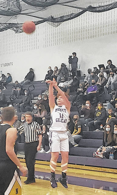 Turner Fitzpatrick goes up for a three-pointer in Mount Gilead's Tuesday contest with Northmor. MG hit nine three-pointers in their 64-49 win.