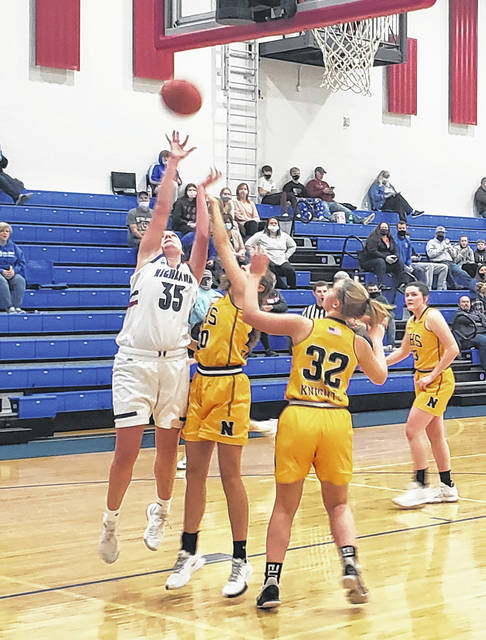 Highland's Maddy Gordon works inside for a shot against Northmor Saturday afternoon.