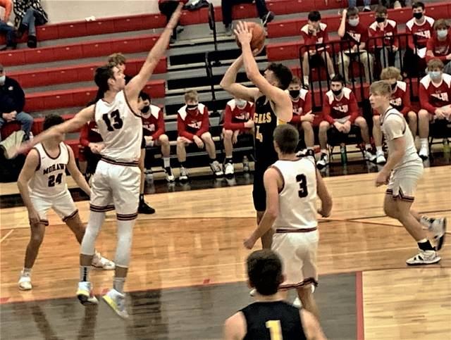 Colonel Crawford's Brock Ritzhaupt shoots over Mohawk's AJ Hess during the Northern 10 Athletic Conference matchup played Saturday, Jan. 30, 2021, at Sycamore. The Eagles prevailed 53-38 to capture their 16th consecutive win and remain undefeated overall and in conference play.