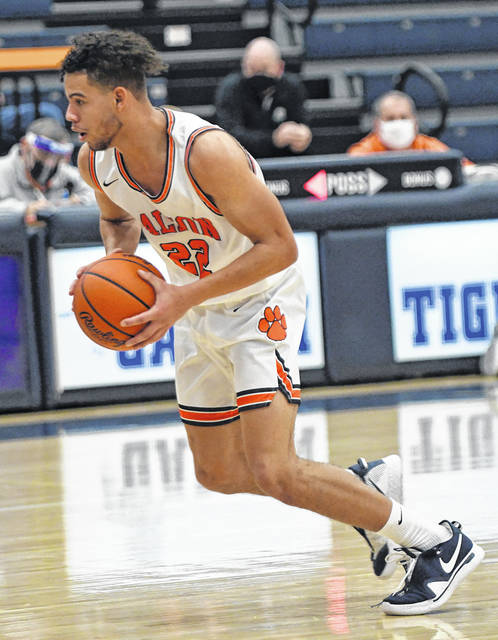 Galion's Hanif Donaldson drives to the basket during the Tigers 51-24 loss to Madison on Tuesday, Feb. 2, 2021. Donaldson and Rece Payne each scored seven points to lead Galion.