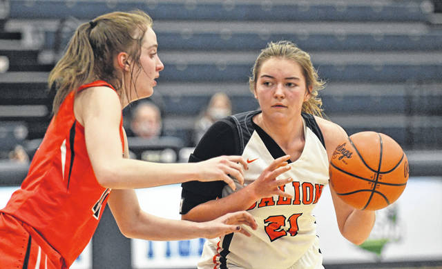Bucyrus freshman Emma Tyrrell, left, and Galion junior Natalee Perkins, right, battle each other during the Lady Tigers 40-34 win on Wednesday, Feb. 3, 2021, at Galion High School. Tyrrell led the Lady Red with 12 points while Perkins paced Galion with 10 points and 16 rebounds.