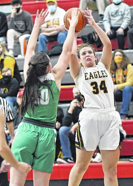 Colonel Crawford senior Allison Teglovic (34) puts up a shot during the Division III district semifinal game against Margaretta on Thursday, Feb. 25, 2021, at Shelby High School. The Lady Bears defeated the Lady Eagles 55-54 thanks to a late basket by Kylie Leibacher that turned out to be the game-winner.