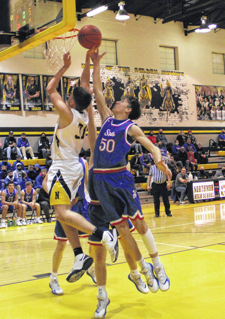Northmor's Preston Harbolt works inside for a lay-up against Highland on Friday.