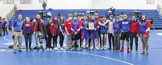 The Highland wrestling team won the KMAC title for the second year in a row. The Scots hosted the meet Saturday and had five individual champions on their way to earning the championship.